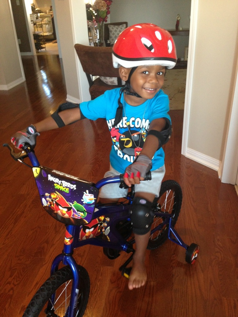 Very excited about his bike...