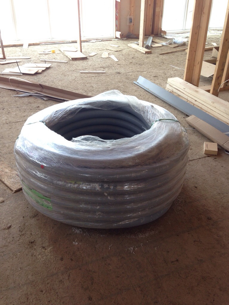 The GIANT spool of conduit tubing once we finally got it home.