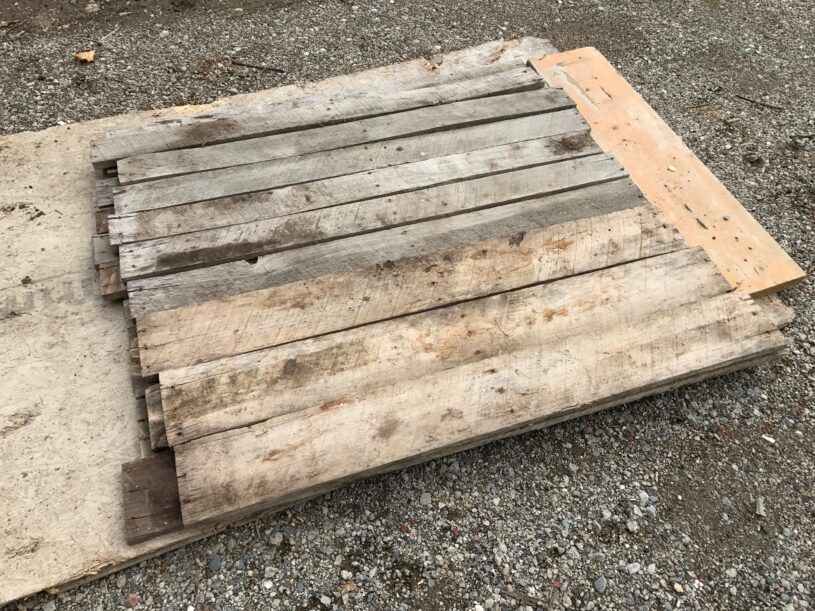 Reclaimed pallet wood for our master bedroom makeover feature wall.