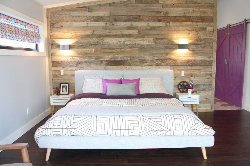 Our dream bedroom pairs modern furniture with a rustic reclaimed pallet wall | Dream Bedroom Reveal - The Dreamhouse Project