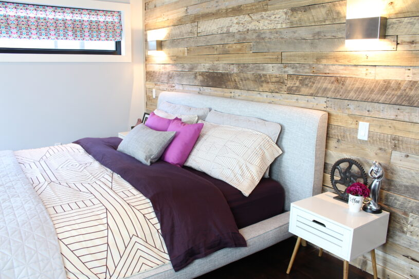 Modern bed with pallet wall, nightstand and DIY faux roman blinds | Dream Bedroom Reveal - The Dreamhouse Project