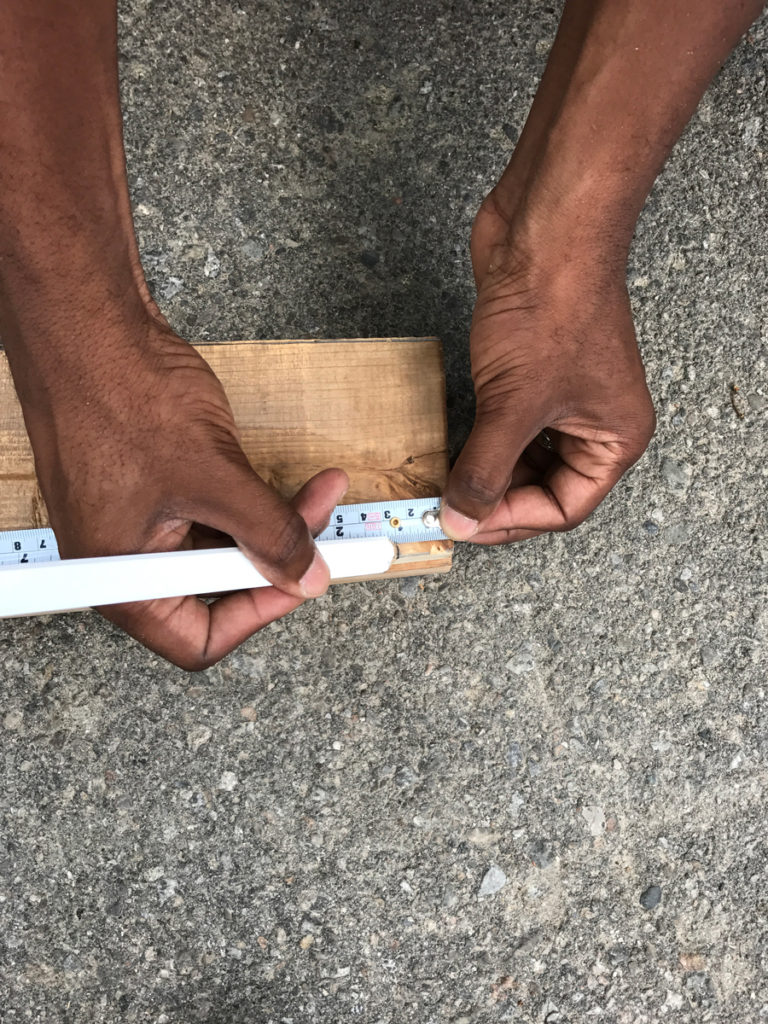 Measure tapered front edge of L frame