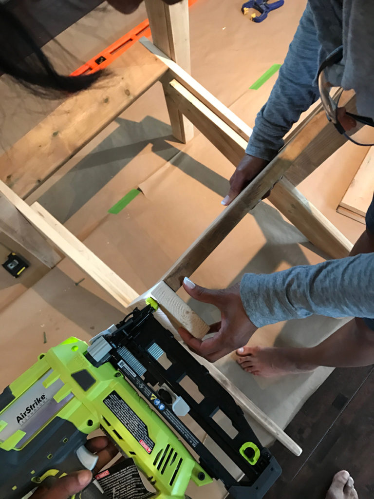 Connect the left & right sides of the L-frame by attaching the front seating board & top back board