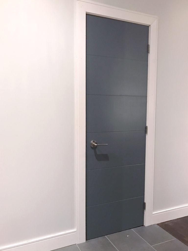 Our upgraded powder room door - Melrose Moulded Panel Door from Metrie painted in PARA 'Mama's Boy'