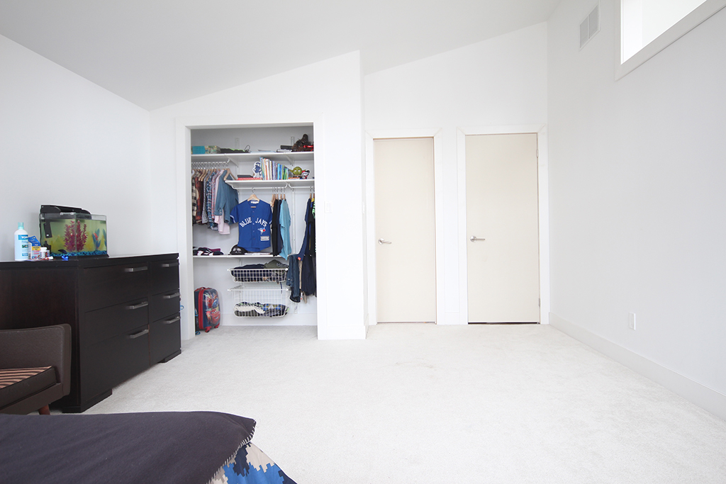 Boys bedroom before: blank walls & unpainted doors create and uninspiring space.