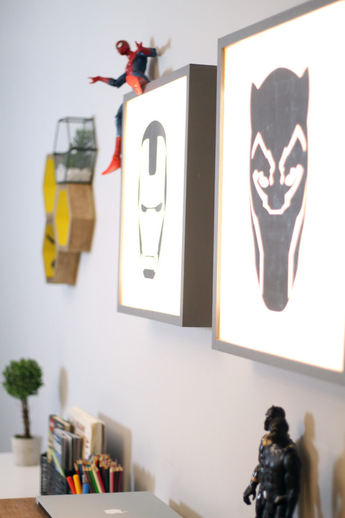 Superhero light boxes & decor accents in our Modern Marvel Bedroom makeover allow us to keep the furniture neutral.