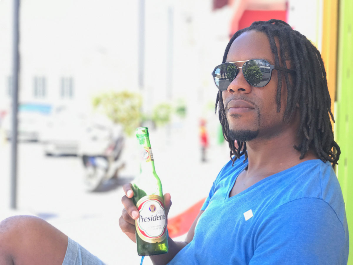 Kes enjoying a cold beer downtown Puerto Plata, Dominican Republic