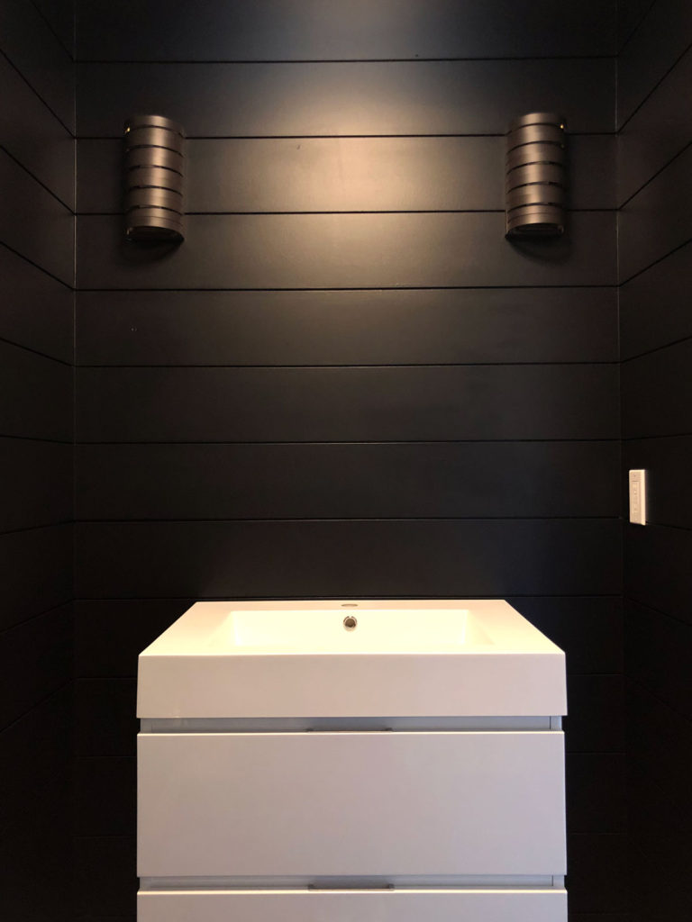 A first look at the beautiful modern shiplap walls painted black