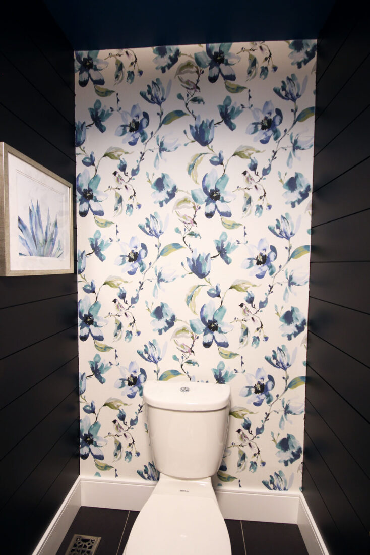 The DIY fabric wallpaper feature & black shiplap walls are the striking focal points for this stylish powder room