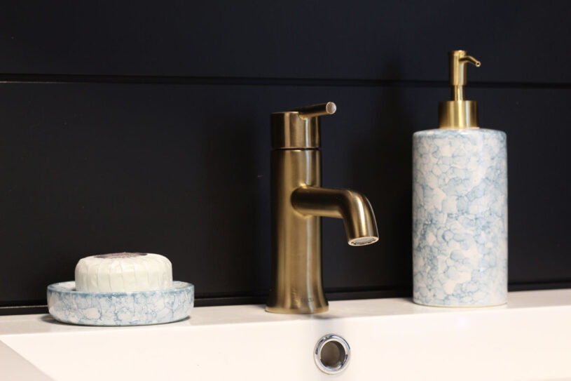 The Delta Trinsic faucet in champagne bronze is a lovely complement to the space
