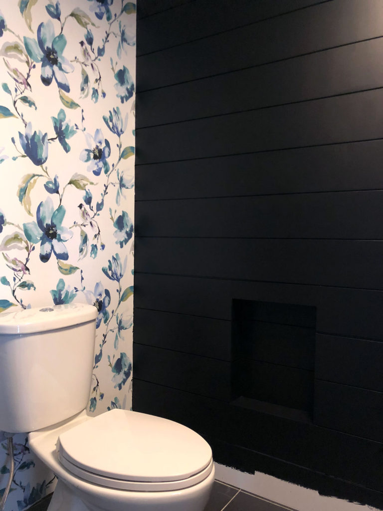 Love the contrast of our DIY fabric wallpaper feature against the black shiplap walls
