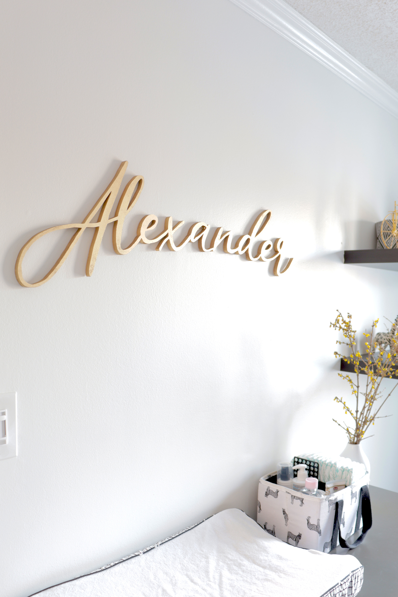 Custom handmade 'Alexander' name sign provides a sweet introduction for baby A into his new room