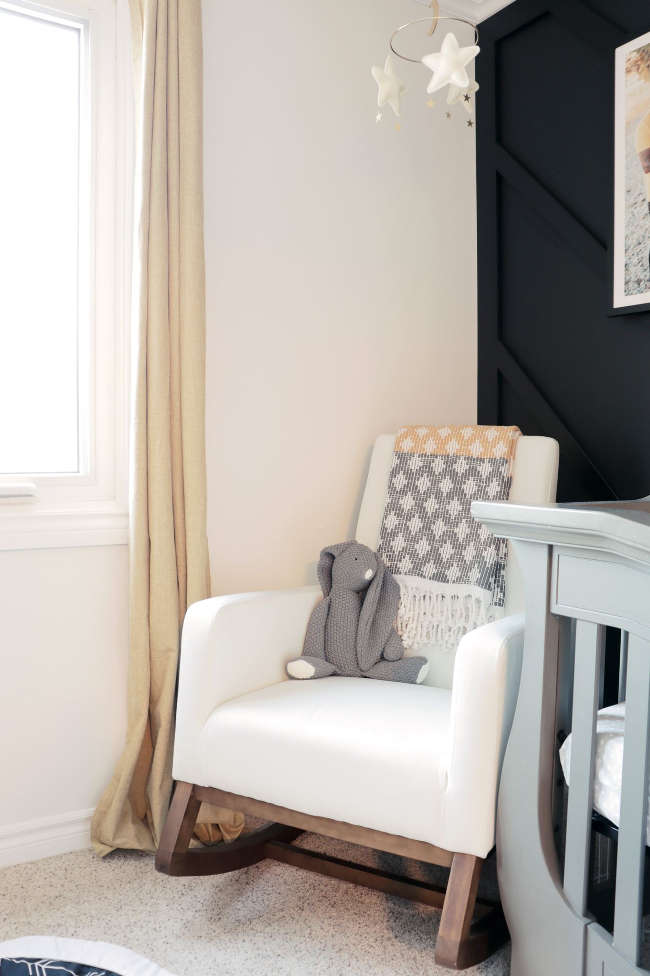 The Azte rocking chair in the corner of the nursery is a cozy spot to snuggle with baby